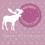 Merry Christmas. Abstract colorful background with moose silhouette, snowflakes and the text Merry Christmas written with white letters Royalty Free Stock Image