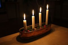 Merry Christmas!. An Advent candle holder with four burning candles Stock Photos