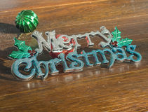 Merry Christmas alphabet on wooden background Stock Images