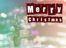 Merry Christmas. alphabet Word on Red paper tags on bokeh lights Royalty Free Stock Photos