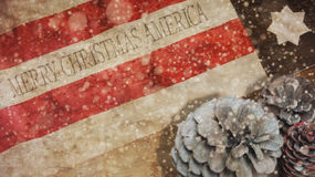 Merry Christmas America. Snow and Pine Cones. Merry Christmas America. Snow and Flag on Wood. Pine Cones Royalty Free Stock Photos