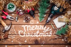 Free Merry Christmas And Happy New Years Handy Constrcution Tools Background Concept. Handy House Fix DIY Handy Tools With Christmas Stock Image - 164615881