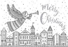 Merry Christmas angel with horn  flying above night city Royalty Free Stock Photography