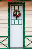 Merry Christmas Arrangement on a Wood Door Royalty Free Stock Images
