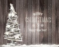 Merry Christmas background with Christmas tree and snowflakes. Stock Images