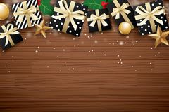 Merry christmas background design template. Gift box and gold ba. Ll on brown wooden Royalty Free Stock Images