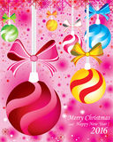 Merry Christmas background with fir branches and the color full balls with decorations on the pink background. Stock Image
