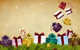Merry christmas background with gift boxes, balloons, candies, and fir tree Stock Photo