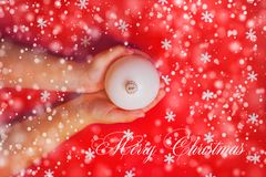 Merry Christmas background or gift card - child`s hands holding Royalty Free Stock Photos
