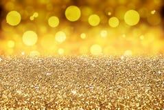 Merry christmas background - golden glitter. Bokeh Stock Images