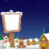 Merry Christmas background. Snowman and wooden sign in winter on blue night sky background. Stock Image