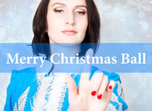 Merry christmas ball written on virtual screen. concept of celebratory technology in internet and networking. woman in Stock Images