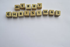 Merry Christmas banner. Wooden blocks spelling the words merry christmas Royalty Free Stock Images