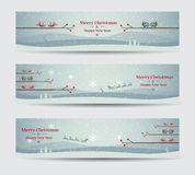 Merry Christmas banners set design with birds Stock Images