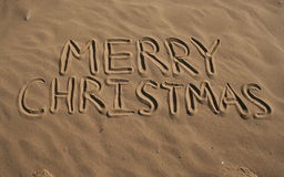 Merry Christmas from beach. Merry Christmas, written in sand at beach Royalty Free Stock Photography