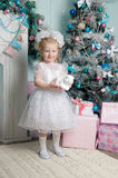 Merry Christmas. Beautiful little girl posing in front of the new year.Isolated studio portrait royalty free stock image