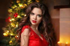 Merry Christmas. Beautiful smiling brunette girl portrait. Red l Stock Photos