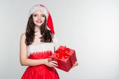 Merry Christmas. Beautiful young woman in a red Mrs. Claus costume and Santa cap. Merry Christmas. Beautiful young woman in a red Mrs. Claus cose and Santa cap stock photo