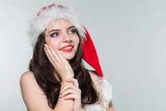 Merry Christmas. Beautiful young woman in a red Mrs. Claus costume and Santa cap. Merry Christmas. Beautiful young woman in a red Mrs. Claus cose and Santa cap royalty free stock photo