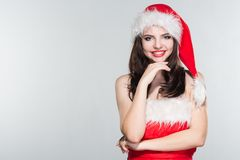Merry Christmas. Beautiful young woman in a red Mrs. Claus costume and Santa cap. Merry Christmas. Beautiful young woman in a red Mrs. Claus cose and Santa cap stock photography