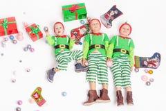 Merry Christmas 2016. Black Friday. Cute little kids Stock Photos