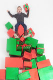 Merry Christmas 2016! Black friday. Happy boy holding Cristmas gift. Merry  2016! Black friday. Happy boy holding Cristmas gift at the top of many gift boxes Stock Photo