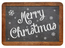 Merry Christmas on blackboard Stock Image