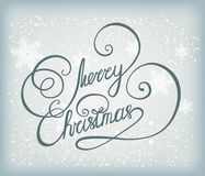 Merry Christmas blue background with snowflakes. Merry Christmas background with snowflakes and lettering. Abstract blue winter background texture for web Stock Images