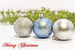 Merry Christmas, blue and gray decorative ball on the white back Stock Photo