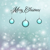 Merry Christmas with blue ornaments Stock Image