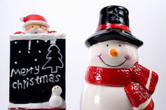 Merry christmas board and snowman doll Royalty Free Stock Photo