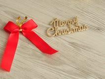 Merry Christmas and a bow Stock Photos