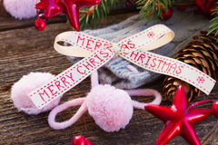 Merry christmas bow with  wool socks Royalty Free Stock Photo