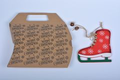 Merry christmas box and skate. Merry christmas sign on brown box stock images
