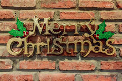 Merry christmas on bricks wall royalty free stock photography