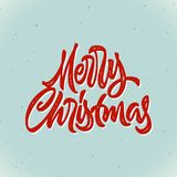 Merry Christmas calligraphic hand drawn lettering card with hipster vintage letterpress style for winter xmas holidays. Merry Christmas calligraphic hand drawn Royalty Free Stock Photography