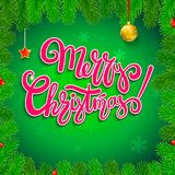 Merry Christmas, calligraphic lettering in the frame of fir branches with new year toys and falling snow-flake on the. Background. Design for posters, print Royalty Free Stock Photos