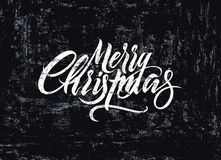 Merry Christmas. Calligraphic retro Christmas card design. Typographic grunge  illustration. Royalty Free Stock Photos