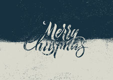 Merry Christmas. Calligraphic retro Christmas card design. Typographic grunge vector illustration. Stock Photo