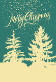 Merry Christmas. Calligraphic retro Christmas card design with winter landscape. Vector illustration. Royalty Free Stock Photography