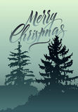 Merry Christmas. Calligraphic retro Christmas greeting card design with winter landscape. Stock Photos