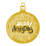 Merry Christmas calligraphy on ball. Handwritten moder. Merry Christmas calligraphy on Christmas ball. Handwritten modern golden brush lettering with Sunburst Stock Images