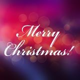 Merry Christmas calligraphy lettering. On the bright holiday background Royalty Free Stock Images
