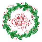Merry Christmas Calligraphy Lettering text and a wreath with fir tree branches. Vector illustration.  Stock Photos