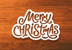 Merry Christmas calligraphy text on paper label stock illustration