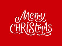 Merry Christmas calligraphy text on red card royalty free stock images