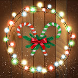 Merry Christmas candy with branches wooden bg Stock Photos