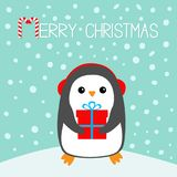Merry Christmas Candy cane. Penguin on snowdrift. Headphones earphones hat. Gift box. Cute cartoon kawaii funny animal character. Flat design. Winter blue snow Royalty Free Stock Photo
