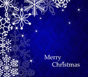 Merry christmas card. Blue christmas background with beautiful snowflakes Royalty Free Stock Photo