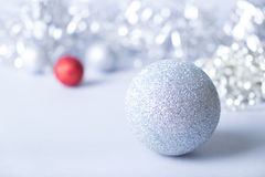 Merry christmas card. Big silver and small red balls on silver background. Christmas and new year card Royalty Free Stock Images